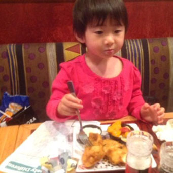A little girl enjoying a meal at Red Lobster.
