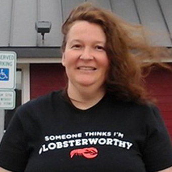 "A woman wearing a ""Someone Thinks I'm #Lobsterworthy"" t-shirt."